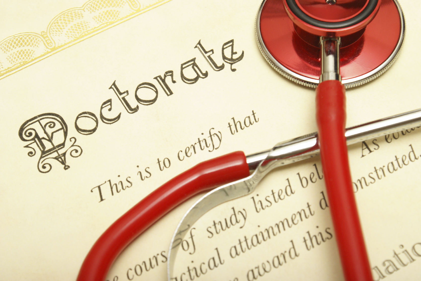 A closeup shot of a doctorate and stethoscope for the medical graduate.